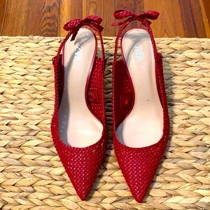 Red, vegan leather sling backs, w/bow detail.